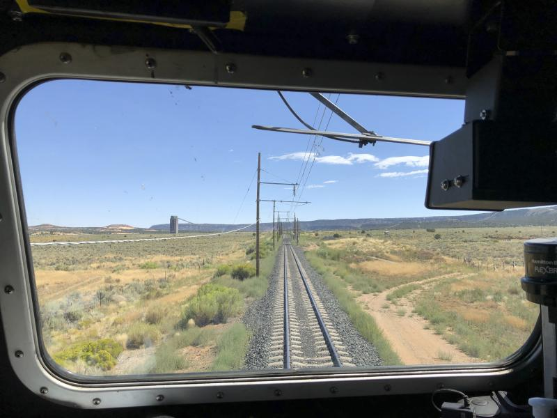 This Aug. 20, 2019, image shows the train tracks that serve as an artery between a coal mine near Kayenta, Ariz. and the coal-fired Navajo Generating Station near Page. The power plant will close before the year ends. (AP Photo/Susan Montoya Bryan)