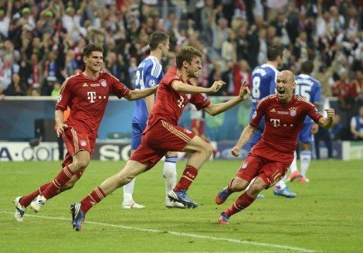 Bayern Munich's forward Thomas Mueller (C) celebrates after scoring a goal during their UEFA Champions League final football match against Chelsea at the Fussball Arena stadium in Munich. The Champions League final went into a penalty shootout on Saturday after the sides were locked at 1-1 at the end of extra-time