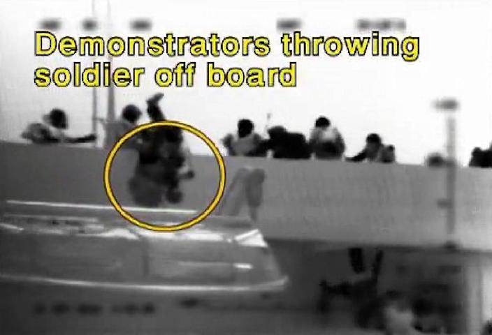 A grab from an Israeli navy video said to show passengers on the Mavi Marmara throwing an Israeli soldier overboard on May 31, 2010 (AFP Photo/)