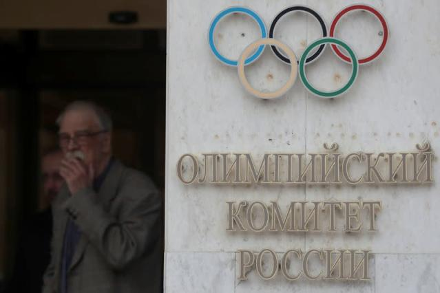 FILE PHOTO: People gather outside the headquarters of the Olympic Committee of Russia in Moscow