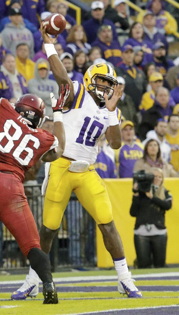 LSU quarterback Anthony Jennings (10) passes against Arkansas in the second half of an NCAA college football game in Baton Rouge, La., Friday, Nov. 29, 2013. LSU defeated Arkansas 31-27. (AP Photo/Bill Haber)