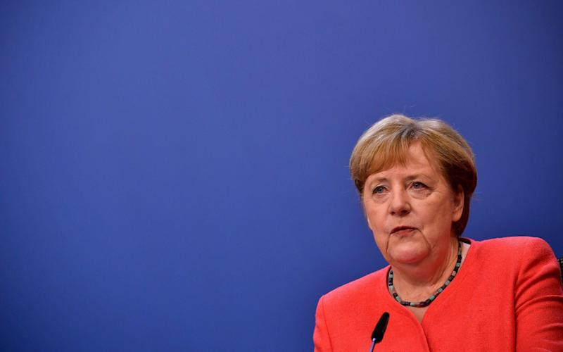 Mandatory Credit: Photo by JOHN THYS/POOL/EPA-EFE/Shutterstock (10717759x) German Chancellor Angela Merkel speaks during a joint video press conference with French President Emmanuel Macron at the end of the European Council in Brussels, Belgium, 21 July 2020. European Union nations leaders agreed on a budget and a recovery mechanism after meeting face-to-face for a fourth day to discuss plans to respond to the coronavirus pandemic and a new long-term EU budget. Special European Council in Brussels, Belgium - 21 Jul 2020 - JOHN THYS/POOL/EPA-EFE/Shutterstock