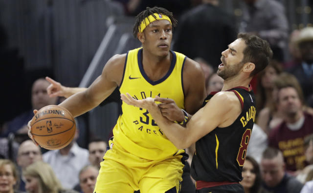 Indiana Pacers' Myles Turner, left, drives past Cleveland Cavaliers' Jose Calderon, from Spain, in the first half of Game 5 of an NBA basketball first-round playoff series, Wednesday, April 25, 2018, in Cleveland. The Cavaliers won 98-95. (AP Photo/Tony Dejak)