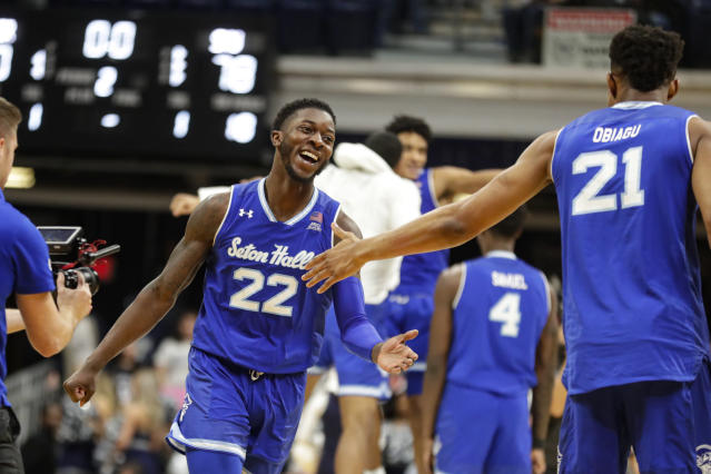 Seton Hall guard Myles Cale (22) celebrates with center Ike Obiagu (21) following an NCAA college basketball game against Butler in Indianapolis, Wednesday, Jan. 15, 2020. Seton Hall defeated Butler 78-70. (AP Photo/Michael Conroy)
