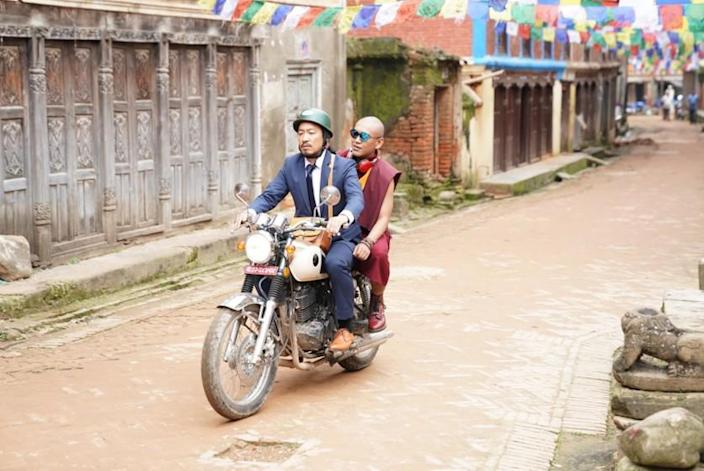 "Tsering Tashi Gyalthang, left, and Tulku Ngawang Tenzin in the movie ""Looking for a Lady With Fangs and a Moustache."""
