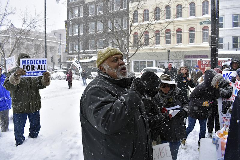 Dohald Bell, of Chicago, speaks at a protest over the proposed health care law in downtown Racine, Wis., on Tuesday, March 14, 2017. A few hundred protesters gathered near House Speaker Paul Ryan's Racine office to protest the American Health Care Act. (Mark Schaaf/The Journal Times via AP) /The Journal Times via AP)