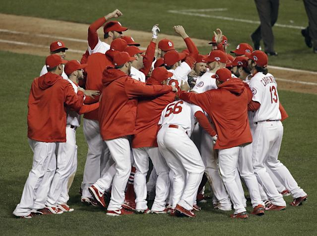 The St. Louis Cardinals celebrate after Game 6 of the National League baseball championship series against the Los Angeles Dodgers, Friday, Oct. 18, 2013, in St. Louis. The Cardinals won 9-0 to win the series. (AP Photo/Charlie Neibergall)