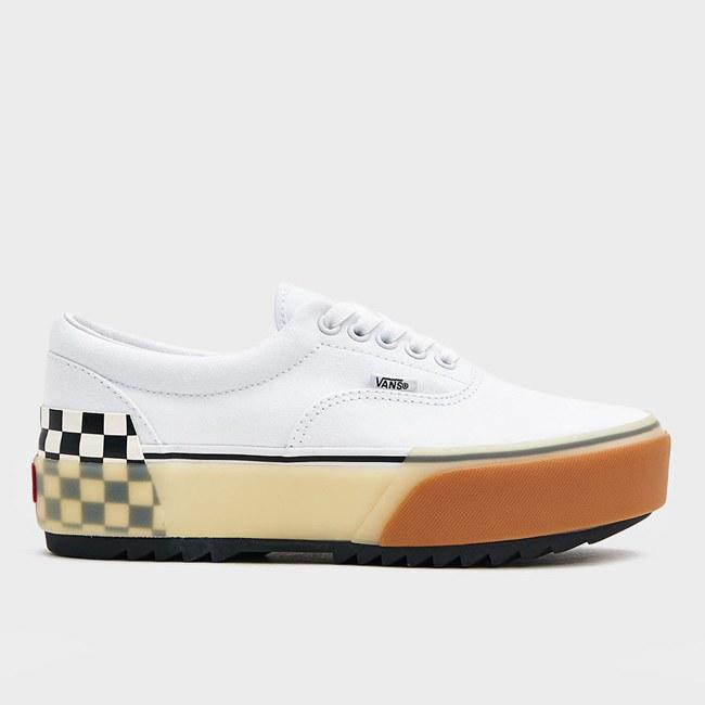 "Behold the perfect pair of Vans. If you wanted a classic white pair, some platforms, and their checkered slip-ons, <em>por qué no los tres</em>? This pair checks off the boxes and surpasses them, too. $70, Need Supply Co.. <a href=""https://needsupply.com/womens/shoes/era-stacked-in-white-checkerboard.html"">Get it now!</a>"