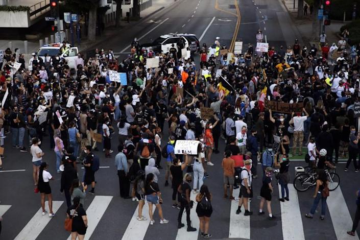 LOS ANGELES, CA - MAY 27: People take to the streets during a Black Lives Matter protest in downtown on Wednesday, May 27, 2020 in Los Angeles, CA. Several hundred protesters, many in masks, converged on downtown as part of a series of national outrage over the death of George Floyd. (Dania Maxwell / Los Angeles Times)