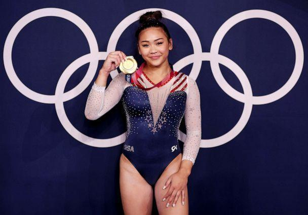PHOTO: Sunisa Lee poses with her Olympic gold medal, July 29, 2021, in Tokyo, Japan. (Jamie Squire/Getty Images)