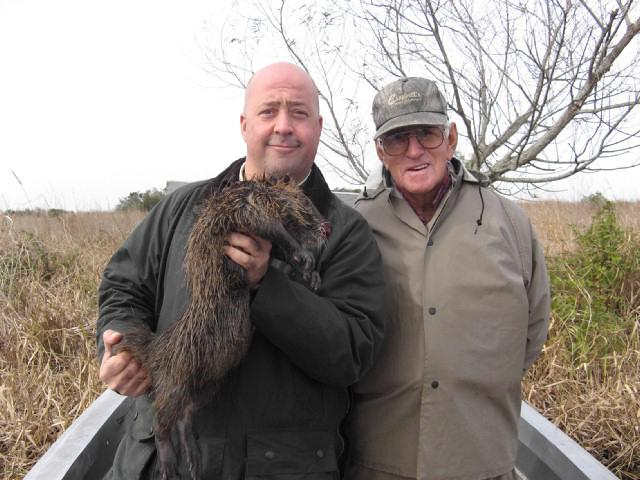 Andrew Zimmern holds nutria, a Cajun delicacy, before it is made into gumbo in Louisiana.