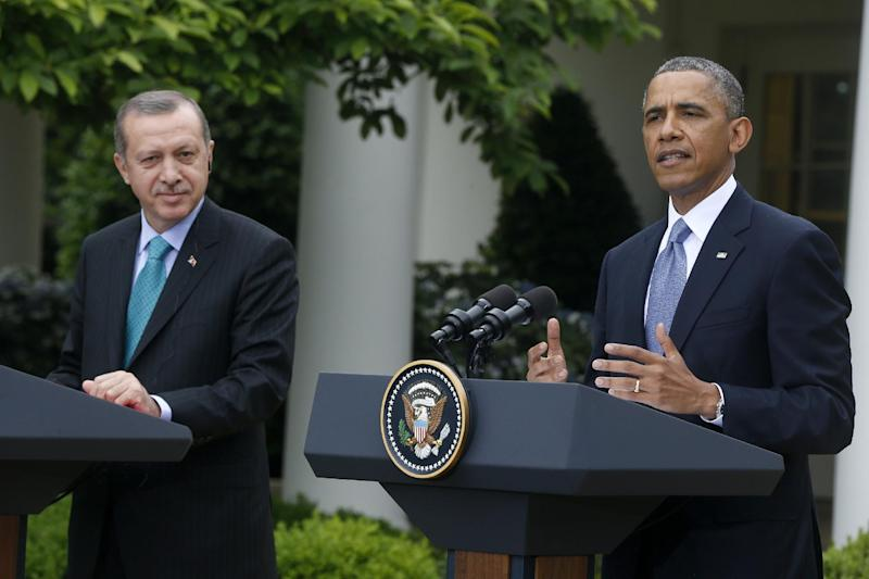 FILE - In this May 16, 2013, file photo, President Barack Obama, accompanied by Turkish Prime Minister Recep Tayyip Erdogan, gestures during their joint news conference in the Rose Garden of the White House in Washington. Government crackdowns against protesters in Turkey could test the close ties between Obama and Erdogan, a strategically important U.S. ally in a tumultuous region. (AP Photo/Charles Dharapak, File)