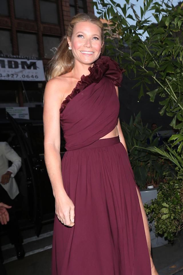 Gwyneth Paltrow, who just arrived back in L.A. after her beachy bachelorette party, attends her star-studded engagement party on April 14. That glow though. Do they sell it on Goop? (Photo: Splash News)
