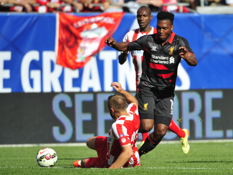 Dimitris Siovas of Olympiacos FC (on ground) challenges Daniel Sturridge during the International Champions Cup 2014 on July 27, 2014 at Soldier Field in Chicago