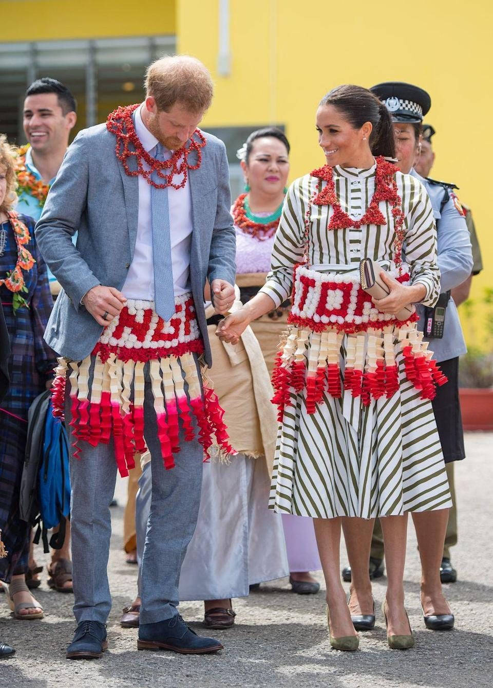 <p>The Duke and Duchess of Sussex dress the part for a visit to an exhibition of Tongan handicrafts, mats and tapa clothswear in Nuku'alofa, Tonga. </p>