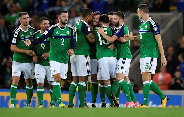 Soccer Football - 2018 World Cup Qualifications - Europe - Northern Ireland vs Czech Republic - Belfast, Britain - September 4, 2017 Northern Ireland's Chris Brunt (C) celebrates scoring their second goal with team mates REUTERS/Clodagh Kilcoyne