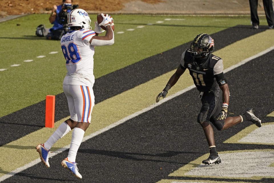 Florida tight end Kemore Gamble (88) catches a touchdown pass ahead of Vanderbilt safety Justin Harris (11) in the second half of an NCAA college football game Saturday, Nov. 21, 2020, in Nashville, Tenn. (AP Photo/Mark Humphrey)