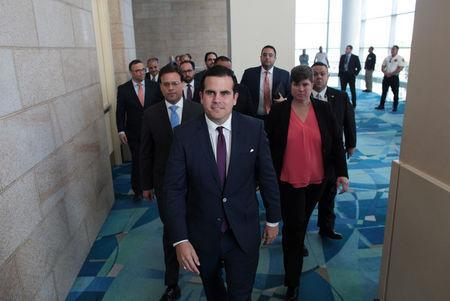 Puerto Rico's Governor Ricardo Rossello (C) arrives for a meeting of the Financial Oversight and Management Board for Puerto Rico at the Convention Center in San Juan, Puerto Rico March 31, 2017. Picture taken March 31, 2017. REUTERS/Alvin Baez