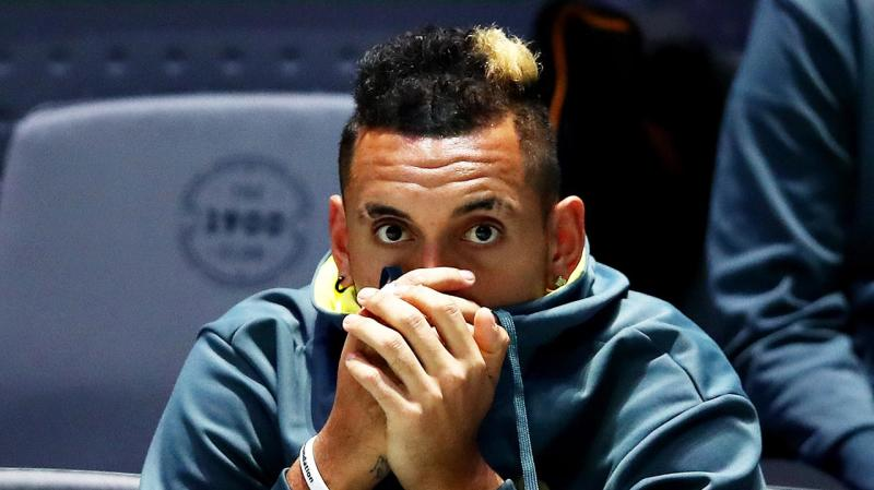 Nick Kyrgios watching the Davis Cup from the sideline.