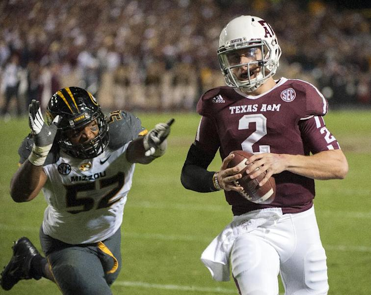 Texas A&M quarterback Johnny Manziel (2) runs from Missouri's Michael Sam (52) during the second quarter of an NCAA college football game on Saturday, Nov. 24, 2012, in College Station, Texas. (AP Photo/Dave Einsel)