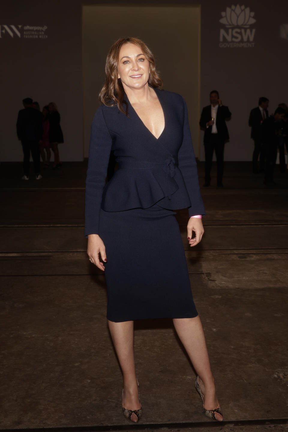 Michelle Bridges wears a navy dress at the Rebecca Vallance show during Afterpay Australian Fashion Week 2021 Resort '22 Collections at Carriageworks on May 31, 2021 in Sydney, Australia