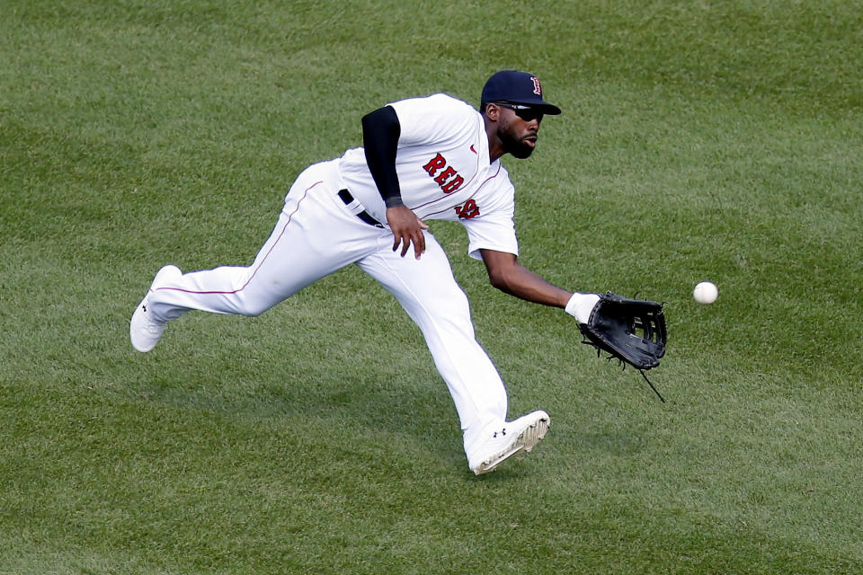 Boston Red Sox's Jackie Bradley Jr. catches a line-out by Baltimore Orioles' Renato Nunez during the seventh inning of a baseball game Saturday, July 25, 2020, in Boston. (AP Photo/Michael Dwyer)