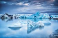 """The glacial lake of Jökulsárlón and its <a href=""""https://www.cntraveler.com/galleries/2015-12-23/10-frozen-lakes-that-will-restore-your-faith-in-winter?mbid=synd_yahoo_rss"""" rel=""""nofollow noopener"""" target=""""_blank"""" data-ylk=""""slk:frozen beach"""" class=""""link rapid-noclick-resp"""">frozen beach</a> are considered natural wonders of Iceland, with black volcanic sands providing a stark backdrop for the chunks of ice that wash ashore. The spot earns even more visual bonus points when it's reflecting the Northern Lights."""