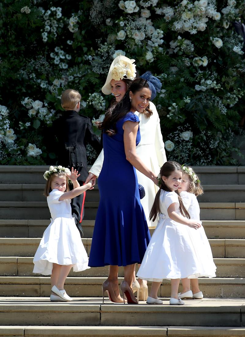 Princess Charlotte of Cambridge, Prince George of Cambridge, Catherine, Duchess of Cambridge, Jessica Mulroney, Ivy Mulroney and Florence van Cutsem after the wedding of Prince Harry and Ms. Meghan Markle at St George's Chapel at Windsor Castle on May 19, 2018 in Windsor, England.