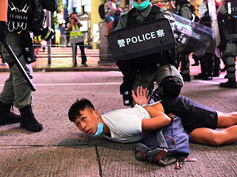 Police officers detain protesters during rally against new national security law: EPA