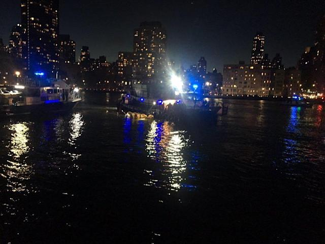<p>This image made from video provided by the New York City Police Department shows the scene of a helicopter crash in the East River in New York on March 11, 2018. (Photo: New York City Police Department via AP) </p>