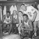 FILE - In this April 9, 1964, file photo, Boston Celtics, from left, Bill Russell, coach Red Auerbach, Tommy Heinsohn, Jim Locustoff, and K.C. Jones celebrate in the locker room after clinching their eighth straight Eastern Division playoff title at the Boston Garden in Boston. Tommy Heinsohn, who as a Boston Celtics player, coach and broadcaster was with the team for all 17 of its NBA championships, has died. He was 86. The team confirmed Heinsohn's death on Tuesday, Nov. 10, 2020.Basketball Hall of Famer K.C. Jones, who won eight NBA championships as a Celtics player in the 1960s and two more as the coach of the Bostons team that took the titles in 1984 and '86, has died. He was 88. (AP Photo, File)