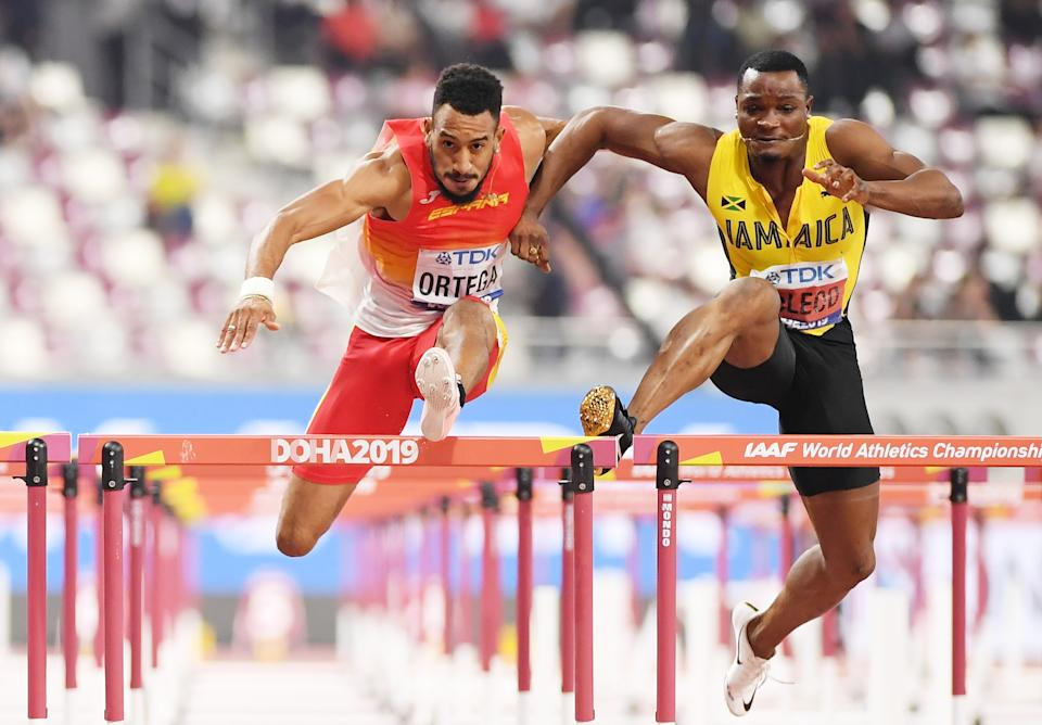 DOHA, QATAR - OCTOBER 02: Orlando Ortega of Spain collides with Omar McLeod of Jamaica in the Men's 110 metres hurdles final during day six of 17th IAAF World Athletics Championships Doha 2019 at Khalifa International Stadium on October 02, 2019 in Doha, Qatar. (Photo by Matthias Hangst/Getty Images)