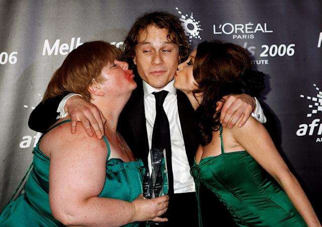 Comedian Magda Szubanski, Heath Ledger, and singer Dannii Minogue share a laugh at the L'Oreal Paris 2006 AFI Awards on Dec. 7, 2006, in Melbourne, Australia. (Photo: Simon Fergusson/Getty Images)