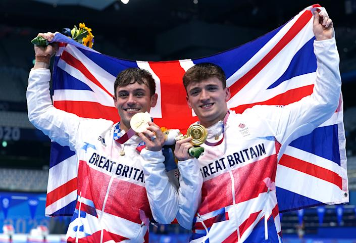 Great Britain's Tom Daley (left) and Matty Lee celebrate winning gold in the Men's Synchronised 10m Platform Final at the Tokyo Aquatics Centre on the third day of the Tokyo 2020 Olympic Games in Japan. Picture date: Monday July 26, 2021.