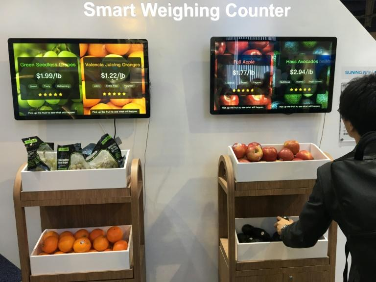 Chinese retail giant Suning's exhibit at the Consumer Electronics Show shows a smart weighing counter that can enable consumers to pick up items and get them scanned automatically to skip the checkout line