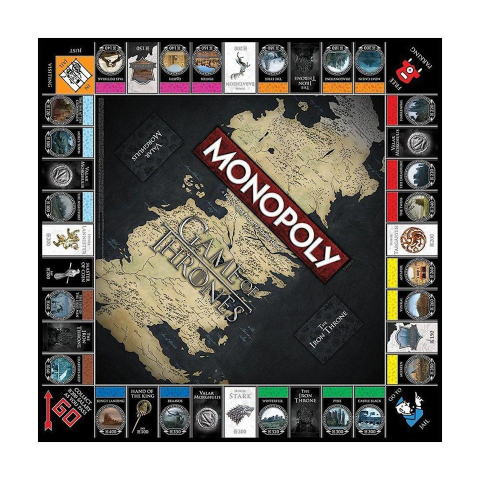 """<p><strong>Monopoly</strong></p><p>amazon.com</p><p><strong>$28.95</strong></p><p><a href=""""https://www.amazon.com/dp/B07K968Q1C?tag=syn-yahoo-20&ascsubtag=%5Bartid%7C2089.g.3486%5Bsrc%7Cyahoo-us"""" rel=""""nofollow noopener"""" target=""""_blank"""" data-ylk=""""slk:Shop Now"""" class=""""link rapid-noclick-resp"""">Shop Now</a></p><p>Clearly, everyone thinks they have what it takes to sit on the Iron Throne. In this version of Monopoly, there are gold coins instead of money, and holdfasts and castles instead of houses and hotels. There's even an iron-throne card holder that plays the <em>GoT</em> theme song.</p>"""