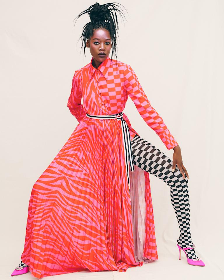 <p>Christopher John Rogers was the talk of New York Fashion Week, even before his fall 2019 presentation. A photo of Whoopi Goldberg in an ethereal white dress by the designer, styled by Solange Franklin for <em>Garage</em> magazine, was all over social media and even made a cameo on <em>The View</em>. When the doors opened for Rogers's presentation on Tuesday, anticipation had reached a fever pitch — and the designer did not disappoint.</p> <p>There were plenty of awe-inspiring gowns: a blue tulle confection with an image of a black woman painted on the bodice, a dress that was basically an explosion of yellow ruffles, and I couldn't stop ogling a black-and-white gown that was half checkered, half zebra print. Even the separates were noteworthy, like a blouse and pleated skirt that seemed traditional at first, but Rogers fashioned it up with gold lame and an oversized pussy bow at the neck.</p> <p>The show had some noteworthy models, too: Model and Instagram star Richie Shazam, who's been killing it on the runway this season, posed in a face-print peplum blouse and ball skirt as editors and photographers snapped away.</p> <p>Christopher John Rogers offers imagination and drama at a time when New York designers are settling for boring and safe. In just his second season, Rogers is quickly making a name for himself in American fashion. Watch out now! — Jessica Andrews, Fashion Features Editor</p>