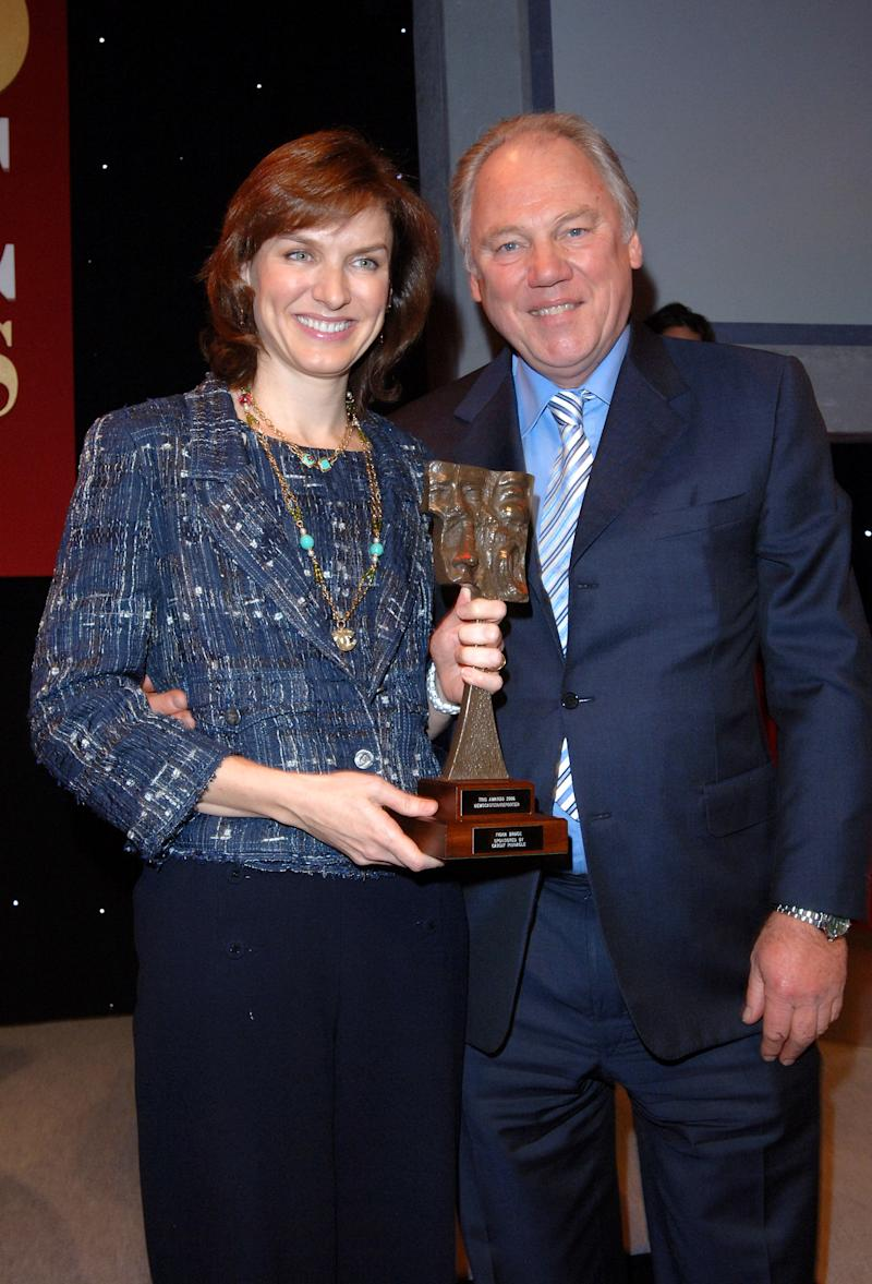 Peter Sissons and Fiona Bruce with her award for best TV Newscaster/Reporter, during the Television and Radio Industries Club (TRIC) Awards, at Grosvenor House, central London, Tuesday 7 March 2006. The awards honour performers and programmes and are voted for by radio and television personnel. PRESS ASSOCIATION Photo. Photo credit should read: Steve Parsons/PA (Photo by Steve Parsons - PA Images/PA Images via Getty Images)