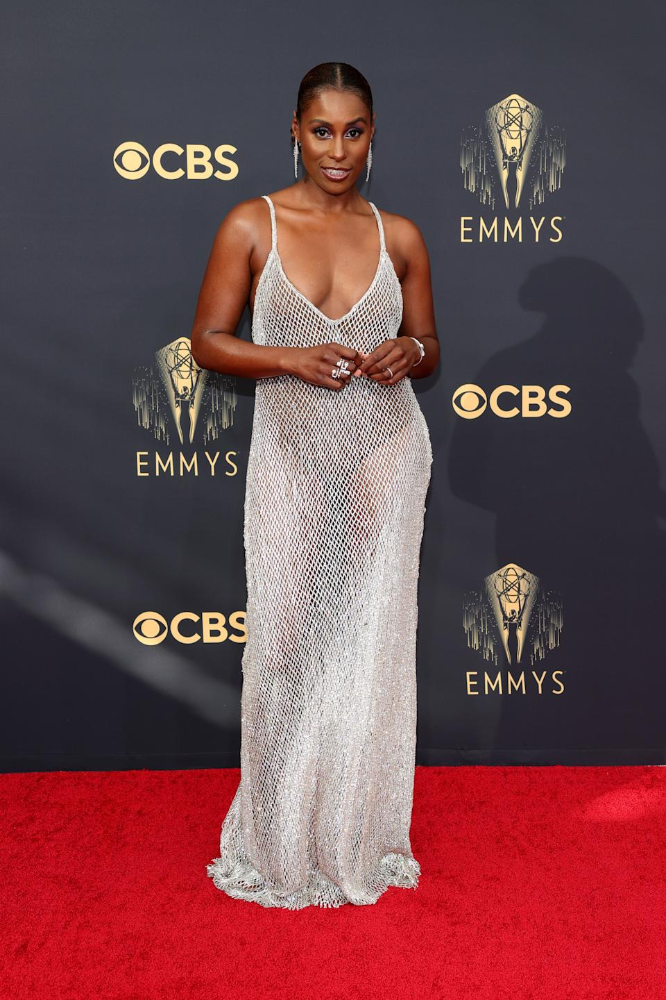 Issa Rae wearing a silver mesh dress at the 73rd Primetime Emmy Awards at L.A. LIVE on September 19, 2021 in Los Angeles, California. (Photo by Rich Fury/Getty Images)