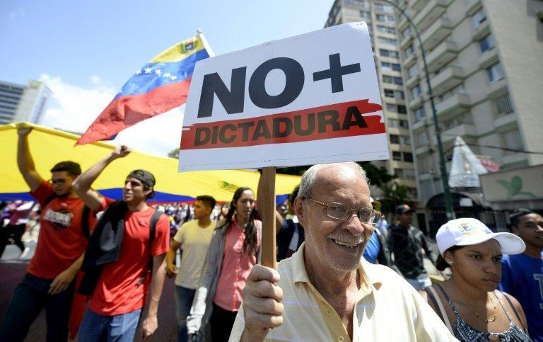 Venezuelan opposition activists shout slogans during a protest against the government of President Nicolas Maduro on April 6, 2017 in Caracas