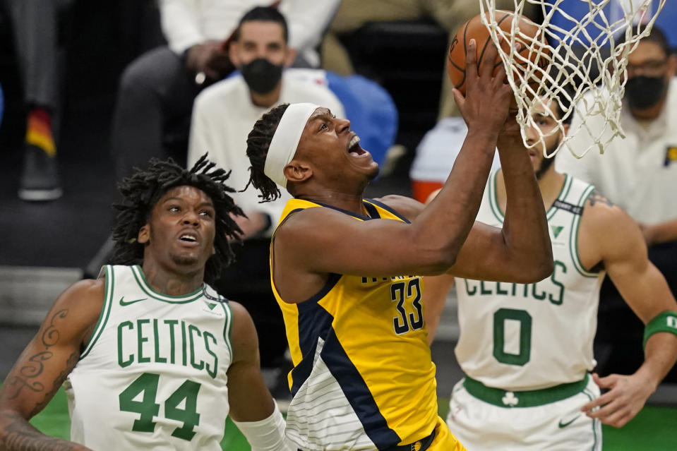 Indiana Pacers center Myles Turner (33) drives to the hoop past Boston Celtics center Robert Williams III (44) in the first quarter of an NBA basketball game, Friday, Feb. 26, 2021, in Boston. (AP Photo/Elise Amendola)