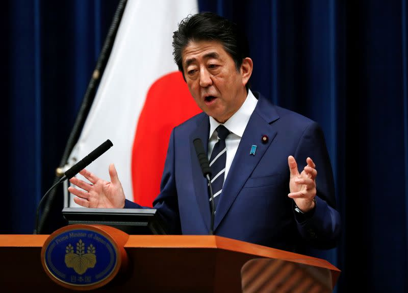 Japan to launch panel to mull big stimulus package to battle hit from virus
