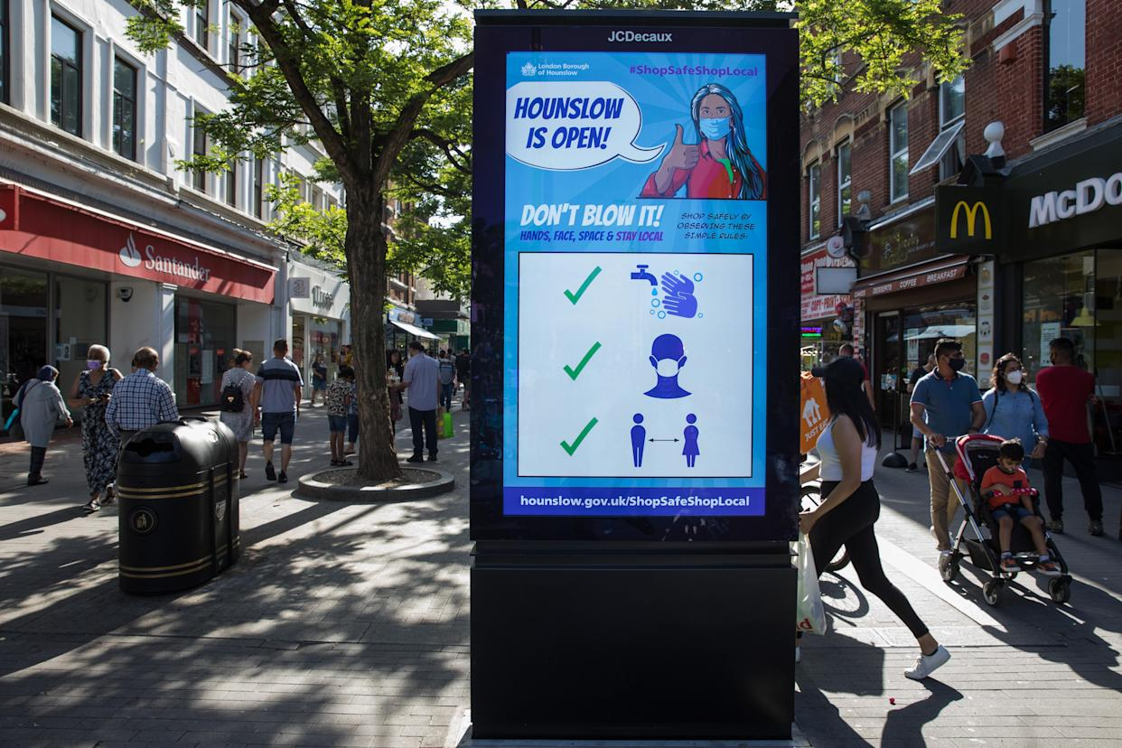 Members of the public pass a London Borough of Hounslow Covid-19 public information display urging residents to take precautions to minimise the spread of the coronavirus amid rising concern regarding the Delta variant on 17th July 2021 in Hounslow, United Kingdom. The UK government is currently still expected to lift almost all restrictions on social contact on 19th July, known as 'Freedom Day', but the current wave driven by the Delta variant is not expected to peak until mid-August. (photo by Mark Kerrison/In Pictures via Getty Images)