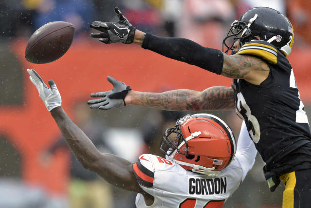 <p>Cleveland Browns wide receiver Josh Gordon (12) can't hold onto the ball under pressure from Pittsburgh Steelers defensive back Joe Haden (23) during the second half of an NFL football game, Sunday, Sept. 9, 2018, in Cleveland. (AP Photo/David Richard) </p>