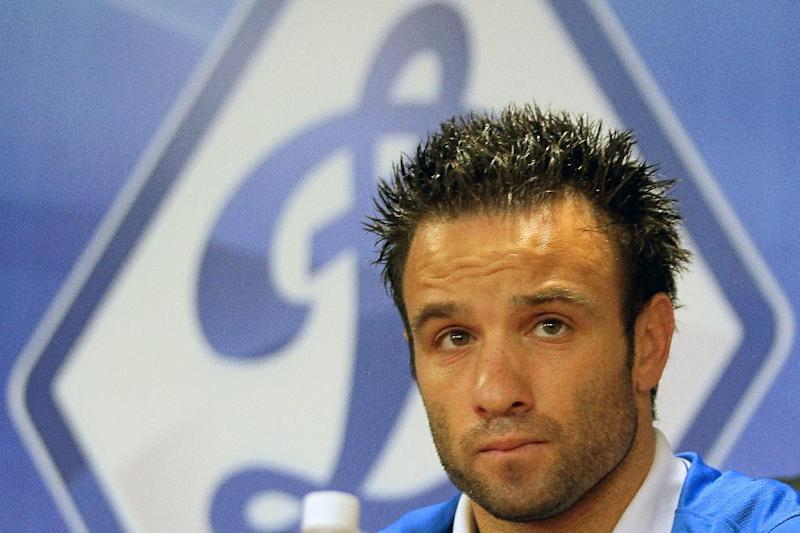 French football player Mathieu Valbuena attends a press conference as he begins a contract with Russian club Dynamo Moscow on August 9, 2014 in Moscow