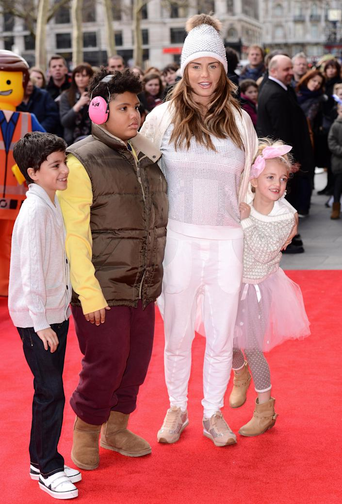 """Katie Price with her children Junior Andre, Harvey Price and Princess Tiaamii Andre attend a VIP screening of """"The Lego Movie"""" at Vue West End on February 9, 2014 in London, England. (Photo by Karwai Tang/Getty Images)"""