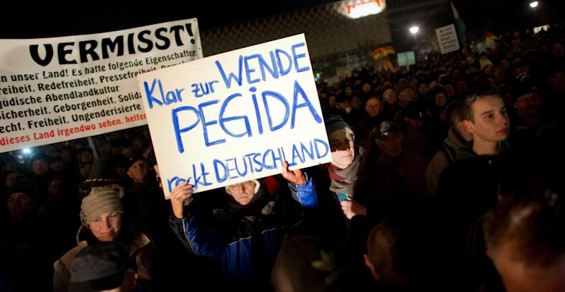 """Supporters of the PEGIDA movement, or """"Patriotic Europeans Against the Islamification of the Occident,"""" during a rally in Dresden, Germany on December 8, 2014 (AFP Photo/Arno Burgi)"""