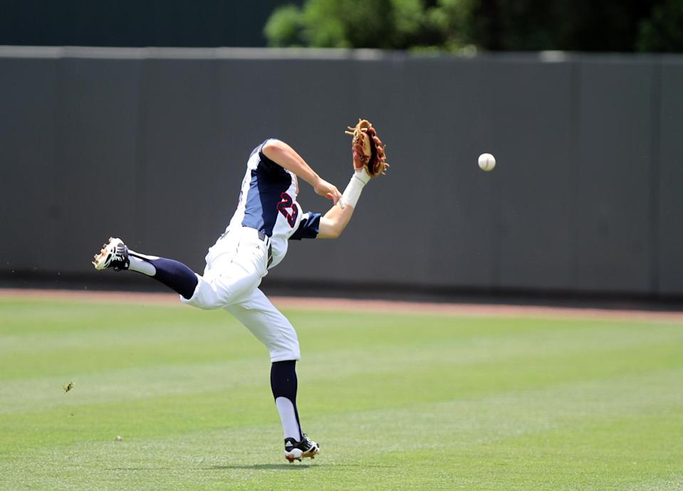 Florida Atlantic second baseman Brendon Sanger can't get to a Towson hit during the first inning of an NCAA regional tournament college baseball game in Chapel Hill, N.C., Friday, May 31, 2013. (AP Photo/Ted Richardson)