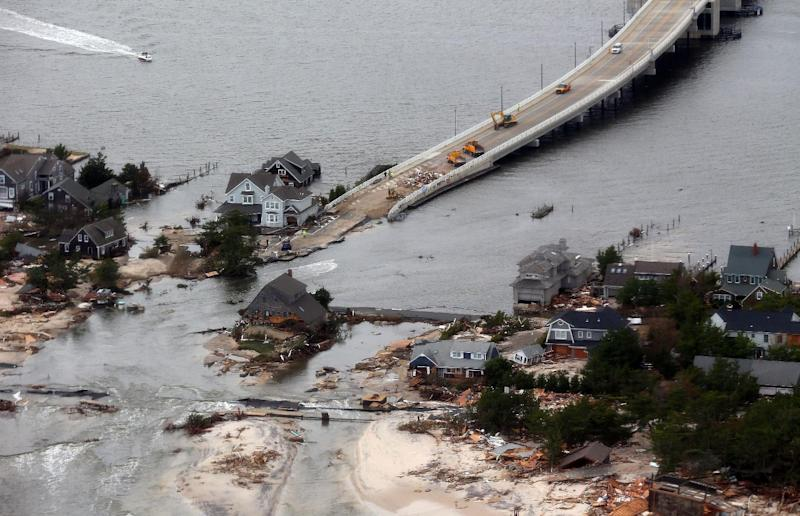 CORRECTS LOCATION - The view of storm damage over the Atlantic Coast in Mantoloking, N.J., Wednesday, Oct. 31, 2012, from a helicopter traveling behind the helicopter carrying President Obama and New Jersey Gov. Chris Christie, as they viewed storm damage from superstorm Sandy. (AP Photo/Doug Mills, Pool)