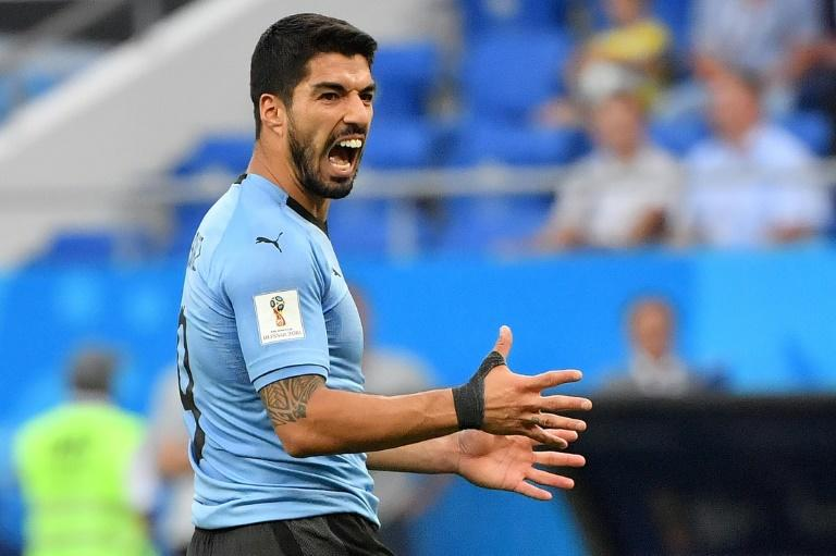 A goal from Luis Suarez sent Uruguay and Russia through to the World Cup knockout phase